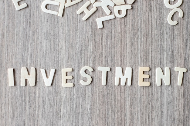 Investment word of wooden alphabet letters. business and idea concept Premium Photo