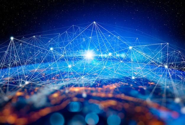 インターネットビジネスのための通信技術。地球暗号通貨およびブロックチェーンとiotのグローバルなネットワークと通信。 nasaから提供されたこの画像の要素 Premium写真
