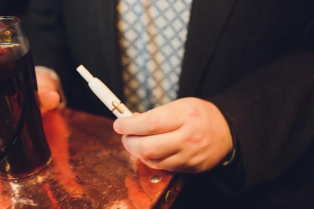 Iqos heat-not-burn tobacco product technology. Premium Photo