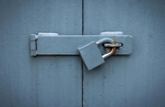 Iron gate with lock, locked metal doors Premium Photo