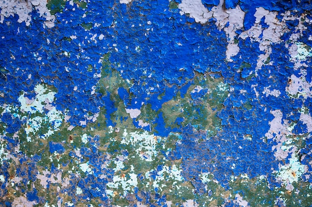 Iron old antique background of dilapidated metal with blue paint in grunge rustic style Premium Photo