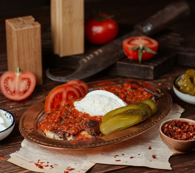 Iskender kebab in tomato sauce with yogurt and marinated food Free Photo