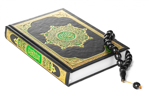 Islamic book holy quran and beads on withe background Premium Photo
