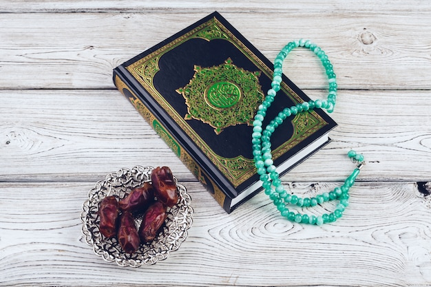 Islamic holy book on wooden table Premium Photo