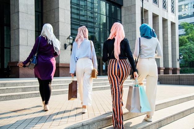Islamic women friends shopping together on the weekend Premium Photo