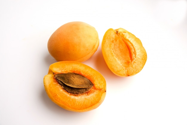 Isolated apricots. fresh whole apricot fruit with leaf and half isolated on white background with clipping path Premium Photo