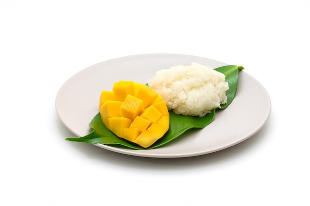 Isolated dish of carve beautiful yellow mango with sticky rice on white Premium Photo