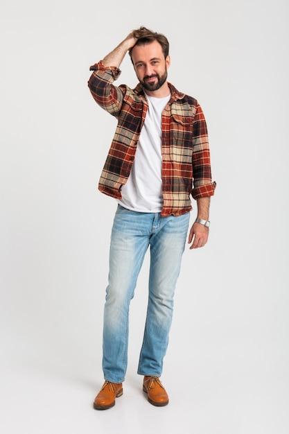 Изолированные красивый бородатый мужчина в хипстерской одежде, одетый в джинсы Бесплатные Фотографии