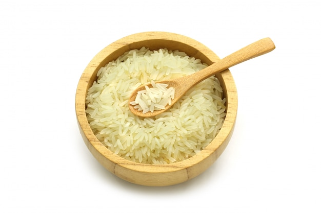 Isolated jasmine rice in a wooden bowl and spoon Premium Photo
