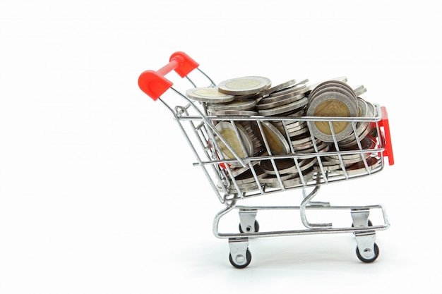 Isolated shopping cart with full wealth coins inside on white ba Premium Photo
