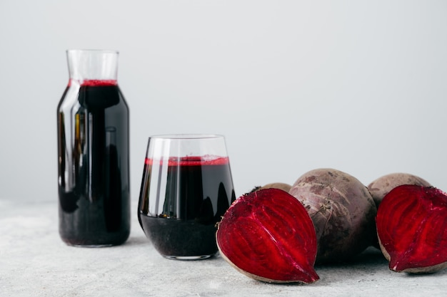 Isolated shot of fresh red beetroot juice and sliced beet. Premium Photo