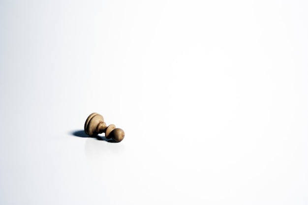 Isolated shot of a white chess pawn on a white background Free Photo
