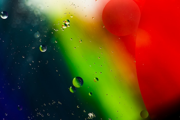 Isolated soap oil bubbles on a watery background Free Photo