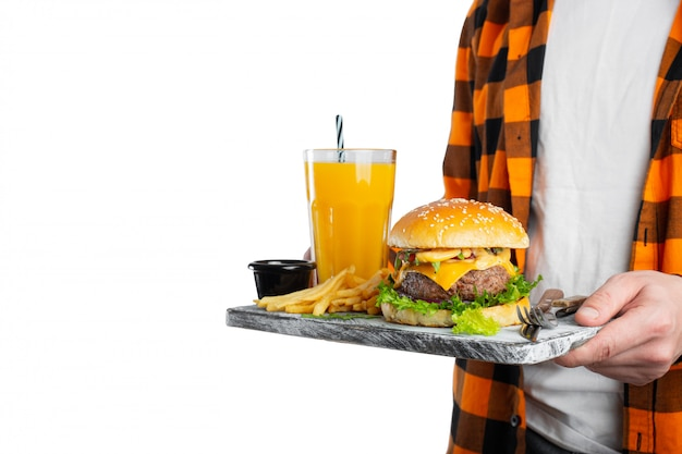 Isolated on white man is holding his lunch on a tray. Premium Photo