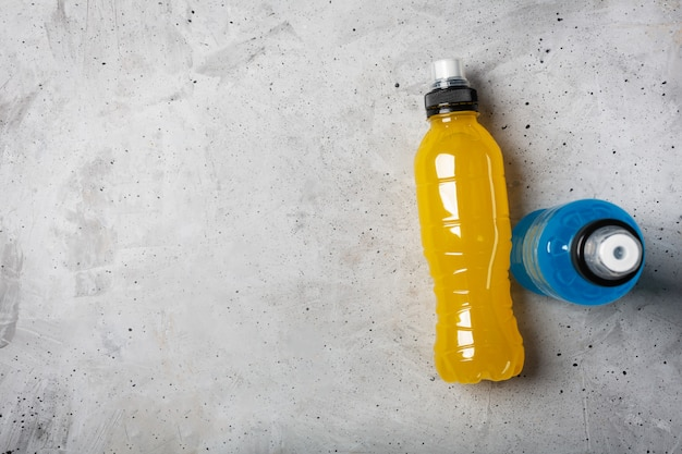 Isotonic energy drink. bottles with blue and yellow transparent liquid Premium Photo