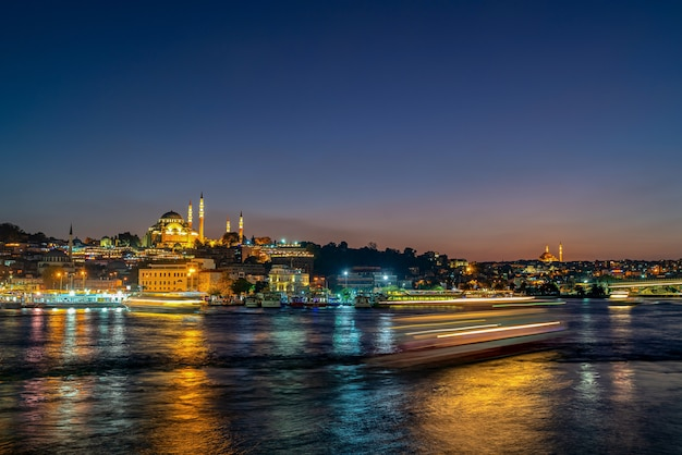 Istanbul city and mosque at night in turkey. and light tail Premium Photo
