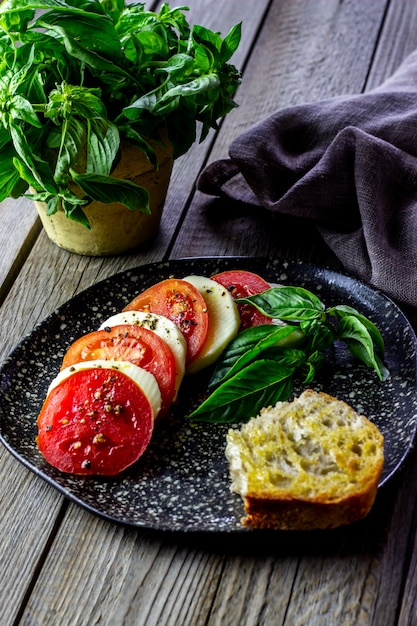 Italian caprese salad with mozzarella and tomatoes. wooden. healthy food. Premium Photo