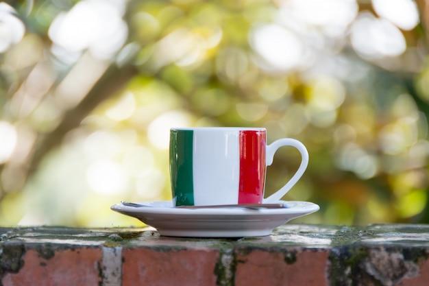 Italian coffee. cup with italian flag Premium Photo