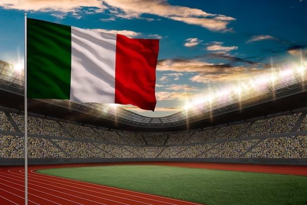 Bandiera italiana davanti a uno stadio di atletica leggera con i tifosi. Foto Gratuite