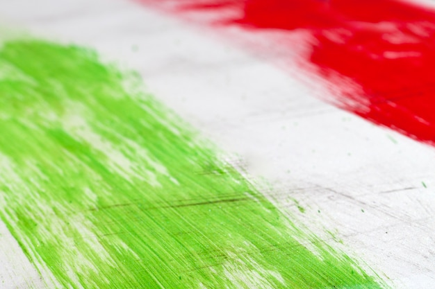 Italian flag painted with  brush strokes on white background. Premium Photo