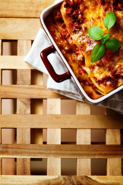 Italian food. lasagna plate on wooden table. Premium Photo