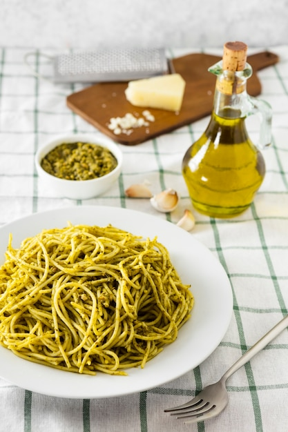 Italian pasta with olive oil bottle and cheese Free Photo