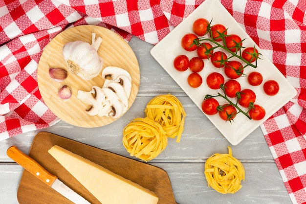 Italian pasta with tomatoes and cheese Free Photo
