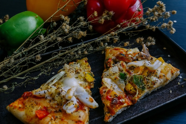 Italian pizza with tomato and pepper on table Premium Photo