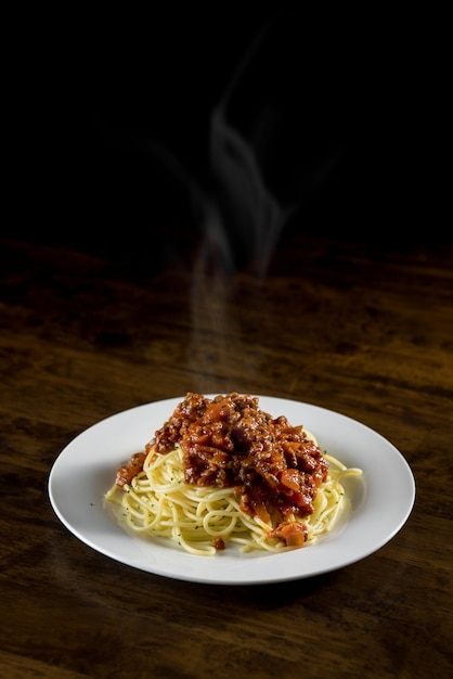 Italian spaghetti with bolognese meat sauce Premium Photo