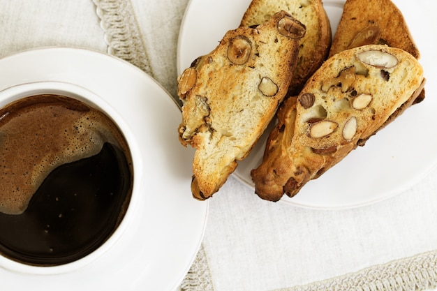 Italian traditional biscotti with nuts on white plate on table. Premium Photo