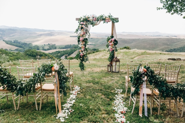 Italian wedding decoration. green eucalyptus, oranges and pink f Free Photo
