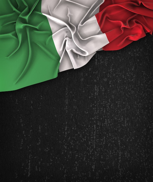 Italy flag vintage on a grunge black chalkboard with space for text Premium Photo