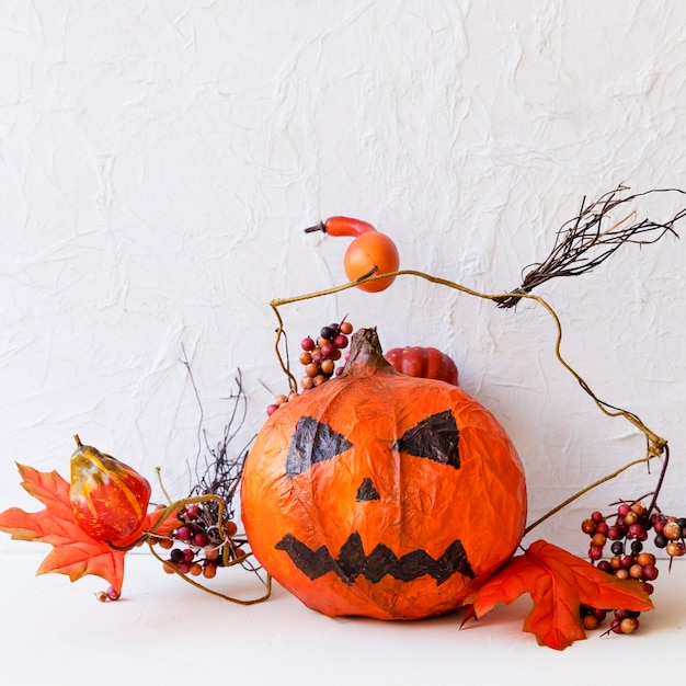 Jack-o-lantern and autumn decorations Free Photo