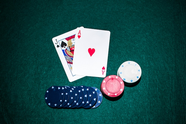 jack-spade-heart-ace-card-with-casino-chips-stack-green-poker-table_23-2147881172.jpg (626 × 417)