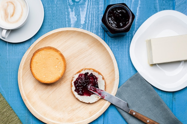 Jam and butter on brioche with cappuccino Free Photo