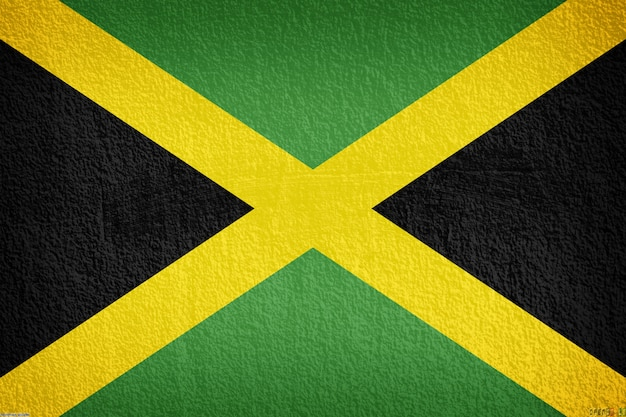 Jamaica flag on the old wall texture Premium Photo