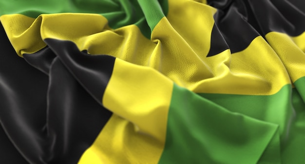 Jamaica flag ruffled beautifully waving macro close-up shot Free Photo