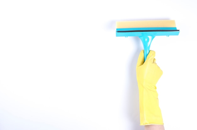 Janitor's hand using squeegee on white background Free Photo