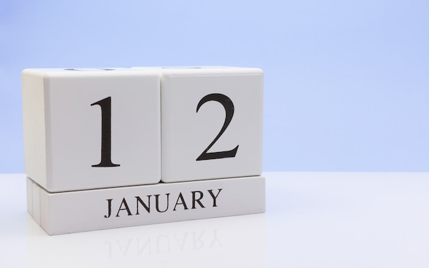 January 12st. day 12 of month, daily calendar on white table with reflection Premium Photo