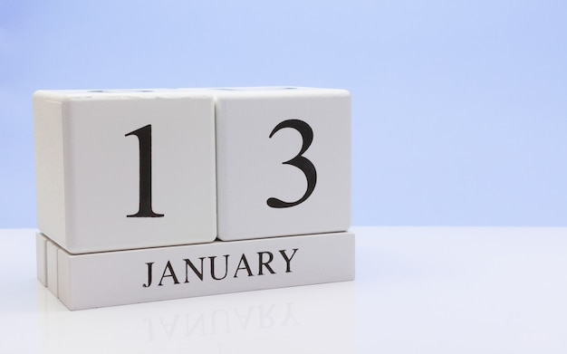 January 13st. day 13 of month, daily calendar on white table with reflection Premium Photo