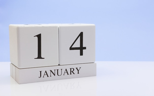 January 14st. day 14 of month, daily calendar on white table with reflection Premium Photo
