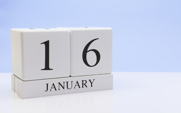 January 16st. day 16 of month, daily calendar on white table with reflection Premium Photo
