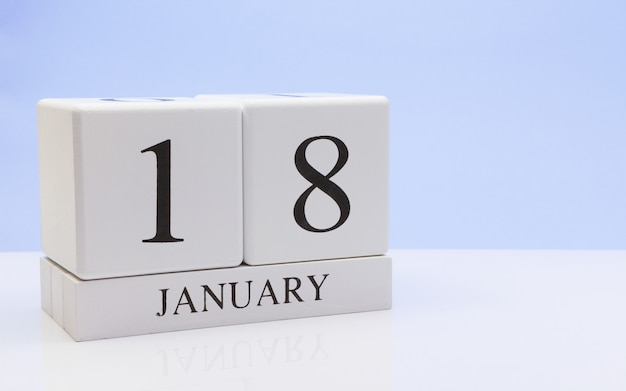 January 18st. day 18 of month, daily calendar on white table with reflection Premium Photo