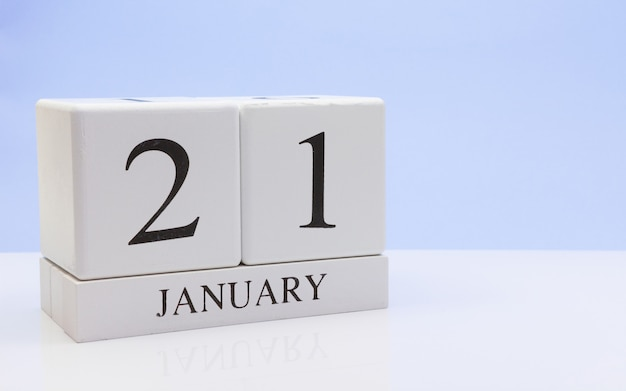January 21st. day 21 of month, daily calendar on white table with reflection Premium Photo