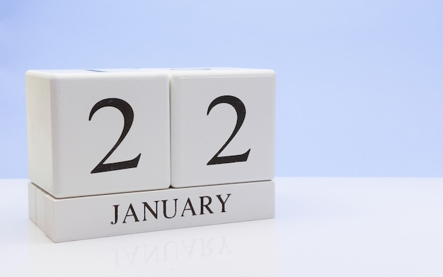 January 22st. day 22 of month, daily calendar on white table with reflection Premium Photo