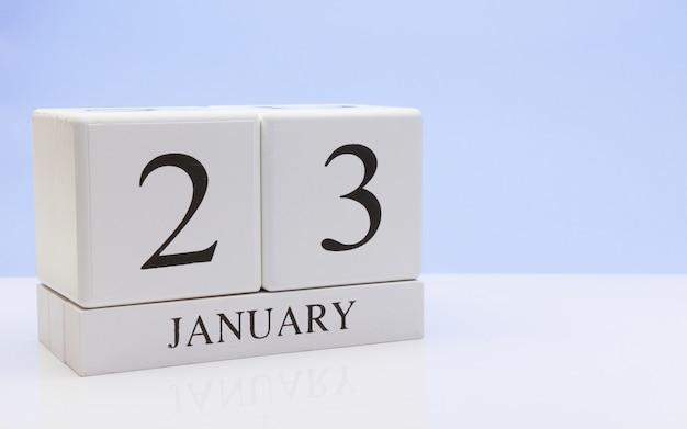 January 23st. day 23 of month, daily calendar on white table with reflection Premium Photo