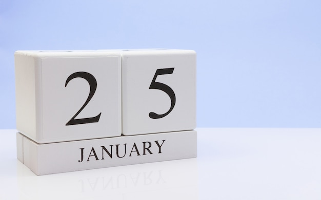 January 25st. day 25 of month, daily calendar on white table with reflection Premium Photo