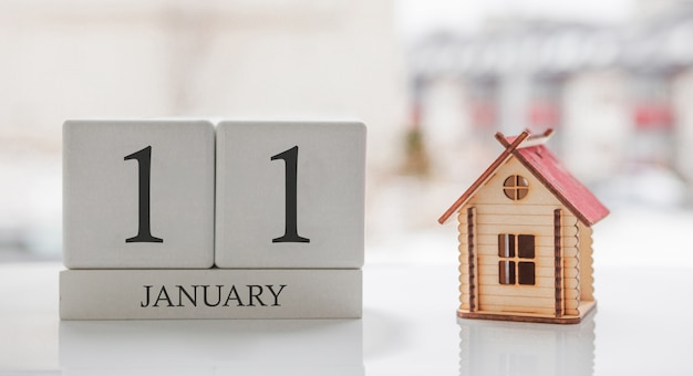 January calendar and toy home. day 11 of month. card message for print or remember Premium Photo