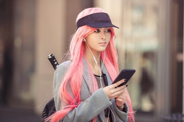 Japan anime cosplay. fashion asian girl outdoors. Premium Photo