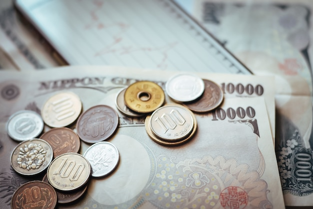 Japan banknotes & coins for business Premium Photo